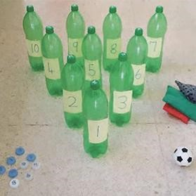 Plastic water bottles turned into numbered bowling pins